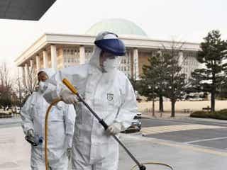 韓国の死者8人、感染者8百人超 国会やサッカー延期