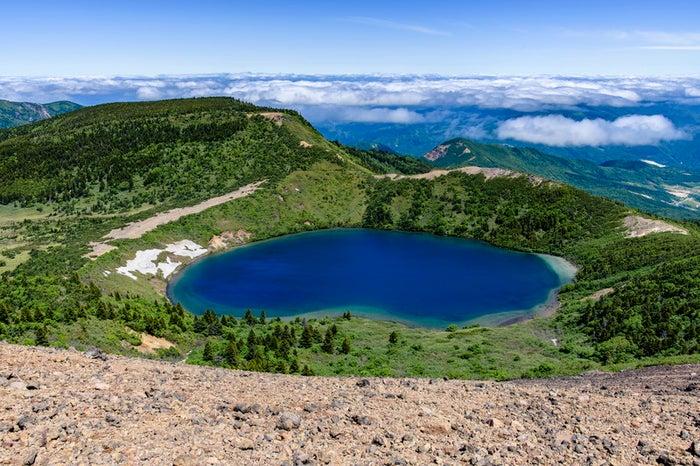 一切経山山頂から見る五色沼(魔女の瞳)/写真素材ぱくたそ
